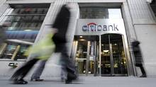 People pass a Citbank branch in New York's Financial District. (RICHARD DREW/AP)