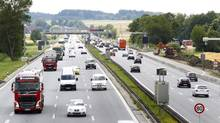 Vehicles drive along the A9 highway in the north of Munich, southern Germany, July 7, 2014. German transport minister Alexander Dobrindt on Monday announced plans on a road toll involving foreign drivers using the German road network. (MICHAELA REHLE/REUTERS)