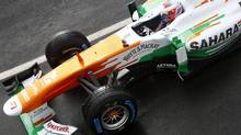 Force India Formula One driver Paul Di Resta test drives the VJM06 car after its official launch (DARREN STAPLES/REUTERS)