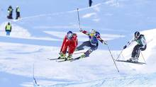 Fanny Smith, left, of Switzerland leads the pack ahead of Marielle Thompson, centre, of Canada and Ophelie David of France to win the women's ski cross event at the Freestyle World Ski Championships in Voss March 10, 2013, in this picture provided by NTB Scanpix. (NTB SCANPIX/REUTERS)