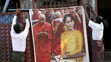 Members of the National Democratic Force party (NDF) put up a poster of Myanmar's detained opposition leader Aung San Suu Kyi at the gate to the party's headquarters in Yangon, Myanmar, Friday, Nov. 5, 2010. Political gatherings are only allowed with a week's notice and an official review of the campaign speech. Hundreds of potential opposition candidates, including pro-democracy hero Aung San Suu Kyi, are under house arrest or in prison. Many of the rrules were clearly written to benefit the proxy party for the ruling junta. (Khin Maung Win/The Associated Press/Khin Maung Win/The Associated Press)