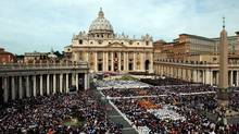 This April 24, 2005 file photo shows thousands of people attending the installment Mass of Pope Benedict XVI in St. Peter's Square, at the Vatican. (Gregorio Borgia/The Associated Press)