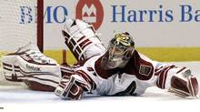 Phoenix Coyotes goalie Mike Smith blocks a shot against the Chicago Blackhawks during the second period of Game 6 of an NHL hockey Stanley Cup first-round playoff series in Chicago. (Nam Y. Huh/Associated Press)