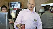 NDP Leader Jack Layton serves a coffee at a Tim Hortons in Welland, Ont., on April 19, 2011. (Jacques Boissinot/THE CANADIAN PRESS)
