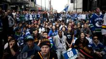 Canucks fans watch the first period in the first game of the Stanley Cup Final at West Georgia Street and Granville Street in Vancouver, British Columbia, Wednesday, June 1, 2011. (Rafal Gerszak for The Globe and Mail/Rafal Gerszak for The Globe and Mail)