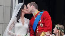 Prince William and Kate Middleton, the Duchess of Cambridge, kiss on the balcony of Buckingham Palace on their wedding day. (John Stillwell/John Stillwell/AP)