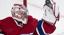Montreal Canadiens goalie Carey Price makes a glove save as they face the Carolina Hurricanes during second period NHL action Tuesday, January 28, 2014 in Montreal. (Paul Chiasson/THE CANADIAN PRESS)