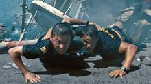 "Tadanobu Asano (left) and Taylor Kitsch in a scene from ""Battleship."" (AP)"