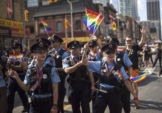 Hamilton, Ont., police officers march along the parade route during the annual Pride Parade in Toronto, Sunday, July 3, 2016.