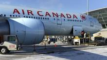 An Air Canada jet sits at the gate at Toronto's Pearson airport. (Fred Lum/Fred Lum/The Globe and Mail)