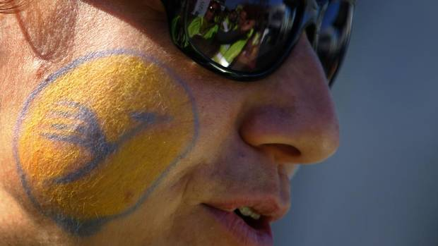 A member of German air carrier Lufthansa's cabin crew union, with the company's logo painted on his face, joins a demonstration at the Fraport airport in Frankfurt on Sept. 7. Lufthansa made a key concession Friday and both sides agreed to a mediator, as a 24-hour walkout that grounded half the airline's flights in Germany entered its final hours. (KAI PFAFFENBACH/REUTERS)