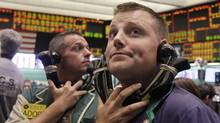 Traders work in the oil options pit of the New York Mercantile Exchange Aug. 22, 2011. Oil prices were mixed Monday as a rebellion in oil-rich Libya appeared close to ending. (Richard Drew/AP/Richard Drew/AP)