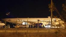 A Syrian passenger plane that was forced to land sits at Esenboga airport in Ankara on Oct. 10, 2012. (Cem Oksuz/Anadolu Agency/REUTERS)