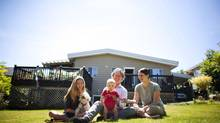 Trevor Erikson, wife Gillian Allan, 16-year-old daughter Shakhti Baker, nine-month-old son Mateo and dog Cody sit outside their home in White Rock, B.C. In 2000, Mr. Erickson moved into a camper van and stayed there for almost four years while he was studlying traditional Chinese medicine at a private Vancouver college. (Rafal Gerszak/The Globe and Mail)