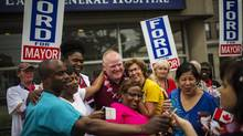 Toronto Mayor Rob Ford poses with members of the public on July 1, 2014, as he takes part in the East York Canada Day Parade in his first public appearance since returning from a rehabilitation clinic for substance abuse problems. (Mark Blinch/Reuters)