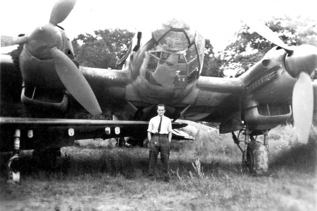 May, 1945: Mr. Smith stands by his bomber during the Second World War.