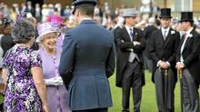 Britain's Queen Elizabeth greets guests at a garden party at Buckingham Palace, in central London, May 29, 2012. (Anthony Devlin/REUTERS)