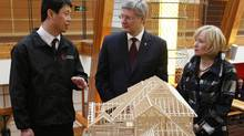 Prime Minister Stephen Harper and his wife Laureen tour the China-Canada Green Design Centre with Leonard Mao, marketing director for Canada Wood, in Langfang, Chinam, on Feb. 9, 2012. (Adrian Wyld/The Canadian Press/Adrian Wyld/The Canadian Press)