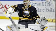 Buffalo Sabres' Ryan Miller makes a save against the Boston Bruins during the second period of an NHL hockey game in Buffalo, N.Y., Thursday, Dec. 19, 2013. (GARY WIEPERT/AP)