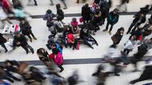 Shoppers make their way through Toronto's Eaton Centre as they visit the Boxing Day sales on Dec. 26, 2013. (CHRIS YOUNG/THE CANADIAN PRESS)