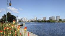 The skyline of Oakland, Calif., along the banks of Lake Merritt. Beijing Zarsion Holdings Group, a small, private developer from Inner Mongolia, has signed a partnership with a U.S. firm to develop 65 acres of waterfront land along the Oakland estuary. (istockphoto.com)