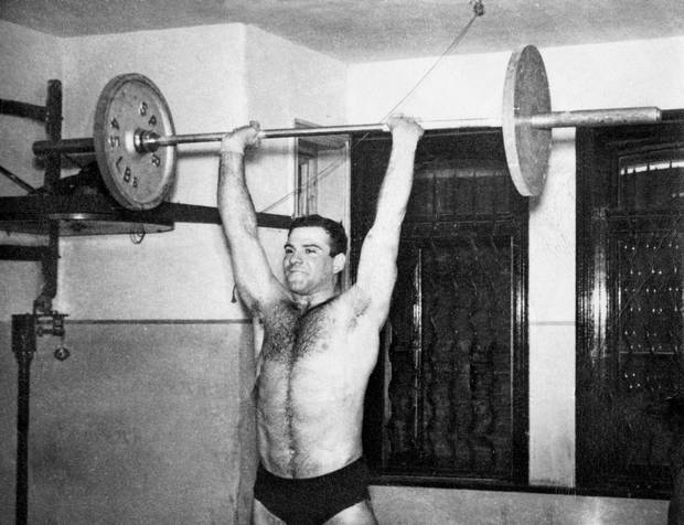 Lifting weights as a novice at the Maccabi club in London, 1956.