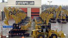 Caterpillar, the maker of heavy equipment sold around the globe, missed earnings expectations this week and sharply reduced its 2013 guidance. So why are the shares up – by roughly 5 per cent – since the news? (ERIC VIDAL/REUTERS)
