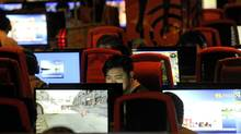 A man surfs the Internet at a coffee shop in Beijing on May 12, 2011. (AFP/Getty Images/LIU JIN/AFP/Getty Images/LIU JIN)