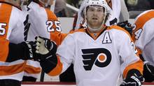 Philadelphia Flyers' Claude Giroux (28) returns to the bench after scoring in the second period of an opening-round NHL playoff series against the Pittsburgh Penguins in Pittsburgh, Friday, April 13, 2012. (Gene J. Puskar/AP)