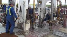 A report by a lobby group for oil refiners finds that Bakken crude is technically permissible to ship under current regulations. Craig Paradis (L) of Advance Drilling, operates the brake handle on a drilling rig for Crescent Point Energy as two roughnecks add a pipe extension to drill deeper into the Bakken formation near Oungre, Saskatchewan in this June 20, 2012 file photo. Shipping crude across North America in railway cars might seem a quaint throwback to the oil pioneering days of the West, but it's a booming business for North America's railroads, and likely to remain an important niche market for years to come after surging from a dribble in 2008 to close to 500,000 barrels per day in September. To Match Analysis RAILWAYS-OIL/NORTHAMERICA REUTERS/Rod Nickel/Files (CANADA - Tags: TRANSPORT BUSINESS COMMODITIES ENERGY) (STAFF/Reuters)