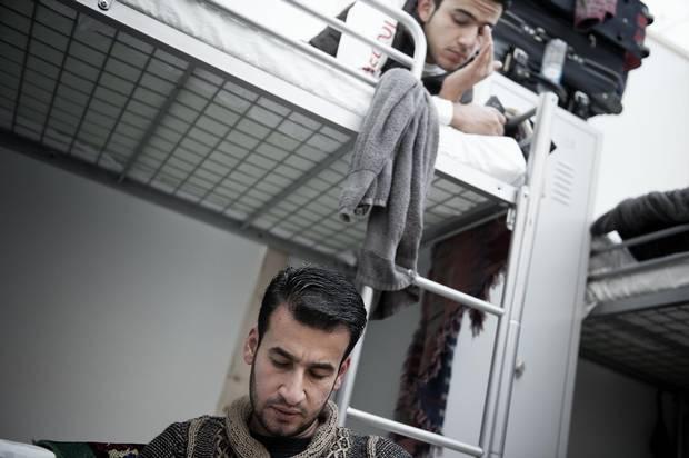 Zain Al Abedin Omran, above, and Basel Omran, below, in their room in the refugee camp at Neubiberg in Munich.