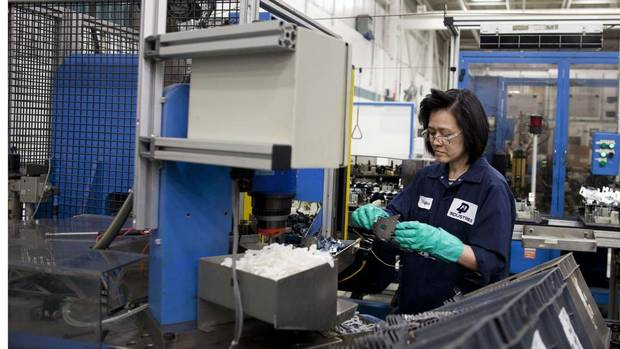 An employee at Magna Closures Dortec Industries in Markham. The threat to Dortec Industries at the turn of the century could be summed up in one word: China. (Moe Doiron/The Globe and Mail)