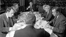 The eight dissenting premiers who disagree with Prime Minister Trudeau's constitutional package sit for breakfast in Ottawa, Nov. 3, 1981. Clockwise from left: Brian Peckford, Newfoundland; Allan Blakney, Saskatchewan; Angus MacLean, P.E.I.; John Buchanan, Nova Scotia; Rene Levesque, Quebec; Peter Lougheed, Alberta; William Bennett, British Columbia; and Sterling Lyon of Manitoba(back to camera). (PETER BREGG/Canadian Press)