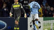 Borussia Dortmund's goalkeeper Roman Weidenfeller (L) reacts after failing to save a penalty kick from Manchester City's Mario Balotelli (R) during their Champions League Group D soccer match in Manchester October 3, 2012. (NIGEL RODDIS/REUTERS)