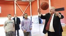 Toronto Mayor Rob Ford shoots hoops during a tour of Ellesmere Community Centre where food and household supplies are being packaged for families in need in Toronto on December 20, 2012. (Michelle Siu/The Globe and Mail)