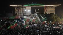 Supporters of cricketer-turned-opposition politician Imran Khan gather in front of the Punjab provincial assembly building, during the Freedom March in Lahore August 14, 2014. (AKHTAR SOOMRO/REUTERS)