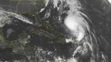 This NOAA satellite image taken Tuesday, Oct. 16, 2012 at 1:45 a.m. EDT shows Hurricane Rafael moving northward between Bermuda and Hispaniola. (Weather Underground/AP)
