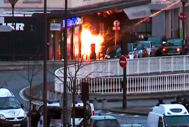 A screengrab taken from an AFP TV video shows French police special forces launching the assault at a kosher grocery store in Porte de Vincennes, Paris
