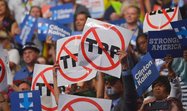 People hold anti-TPP signs at the Democratic National Convention.