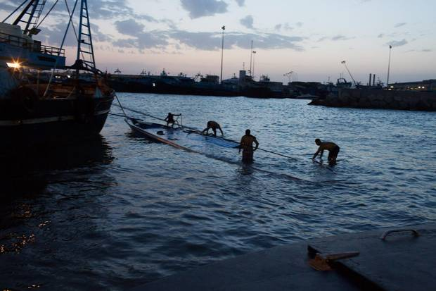 A sunken boat carrying migrants is pulled in to the port in Zuwara, Libya, on Aug. 27, 2015.