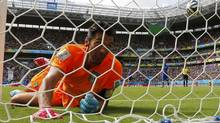 Italy's goalkeeper Gianluigi Buffon lies in the net after conceding a goal scored by Costa Rica's Bryan Ruiz (not pictured) during their 2014 World Cup Group D soccer match at the Pernambuco arena in Recife June 20, 2014. (BRIAN SNYDER/REUTERS)