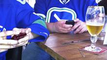 Vancouver hockey fans tweet while watching Game 1 of the Stanley Cup Finals inside a Gastown bar.