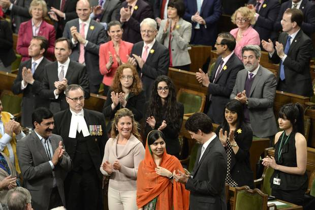 Prime Minister Justin Trudeau, right, and his wife Sophie Grégoire-Trudeau, centre left, clap as Pakistani activist and Nobel Peace Prize winner Malala Yousafzai, centre, is paid tribute in the House of Commons on April 12, 2017.