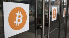 Bitcoin themed stickers stand attached to glass doors during the Inside Bitcoins: The Future of Virtual Currency Conference in New York April 8, 2014. (LUCAS JACKSON/REUTERS)