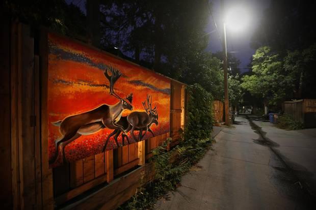 Kal Barteski painted these elk on garage doors in her Wolseley back lane.