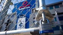 A padlock is seen on a parking lot gate outside Rogers Arena, the home of the Vancouver Canucks, in Vancouver, B.C., on Sunday September 16, 2012. (DARRYL DYCK/THE CANADIAN PRESS)