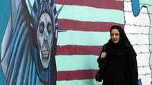 A woman walks past an anti-U.S. mural at the former U.S. embassy in Tehran November 19, 2011. The former U.S. embassy was the site of the 1979-1981 hostage crisis in which a group of militant Iranian students held 52 U.S. diplomats hostage for 444 days. The building is currently being used by the Iranian Revolutionary Guards. (RAHEB HOMAVANDI/REUTERS/RAHEB HOMAVANDI/REUTERS)