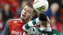 Toronto FC's Danny Koevermans (left) battles for the ball with Santos Laguna's Santiago Hoyos during first half action in the CONCACAF Champions League semi-final in Toronto on Wednesday March 28, 2012. On Tuesday, Toronto FC wakes up with a target on its back as it travels to Torreon, Mexico, for the second leg of its CONCACAF Champions League semi-final with Santos Laguna.THE CANADIAN PRESS/Chris Young (Chris Young/CP)