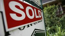 A sold sign in front of a house in Toronto. (Deborah Baic/The Globe and Mail)