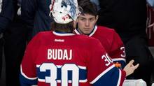 Montreal Canadiens goalie Carey Price listens to Peter Budaj during a break in play as they face the Philadelphia Flyers during third period NHL hockey action Monday, April 15, 2013 in Montreal. The Flyers beat the Canadiens 7-3. (Paul Chiasson/THE CANADIAN PRESS)